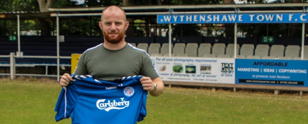 Town sign midfielder Grant Spencer